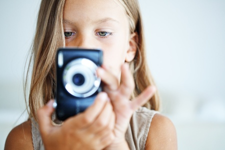 compact camera: Little girl with compact photo camera