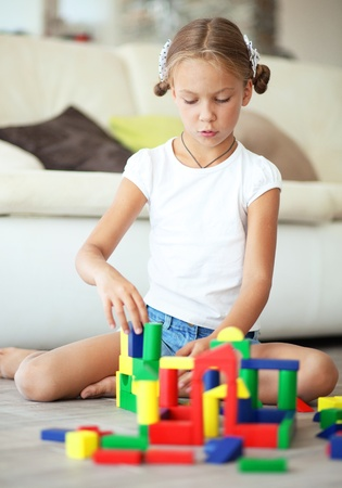 assiduous: Child playing with blocks at home Stock Photo