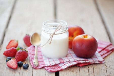 Fruits and milk on wooden background photo
