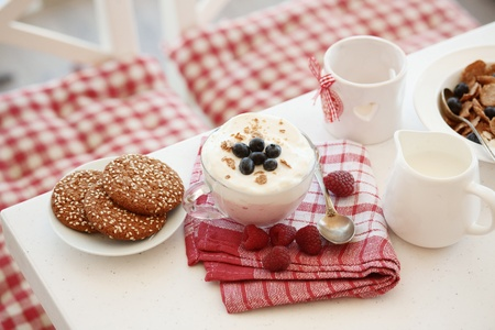 dinning table: Breakfast with summer berries and cereal bread Stock Photo