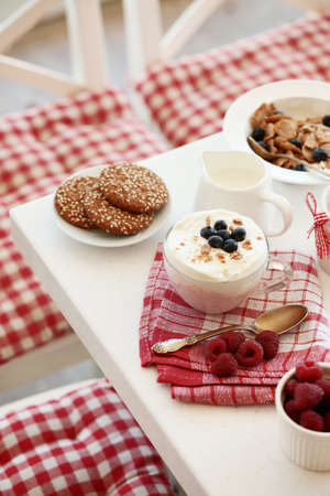 Breakfast with summer berries and cereal bread photo