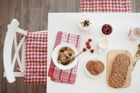 dinning table: Breakfast with summer berries and cereal bread top view