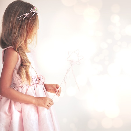 girl magic wand: Beautiful little girl wearing fairy costume with magic wand