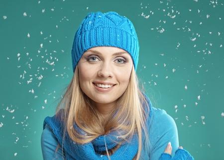 blonde  blue eyes: Portrait of beautiful young girl wearing winter clothing studio shot Stock Photo