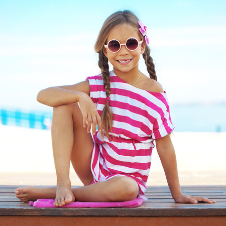 preteen girls: Child resting at the summer beach