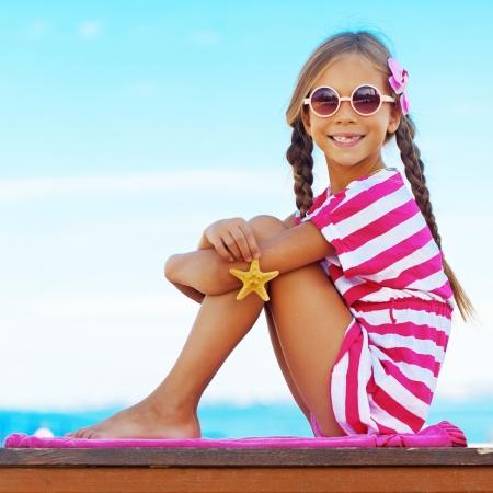 preteens beach: Child holding seashell on the summer beach