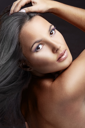 Portrait of beautiful woman with perfect make up and glossy hair photo