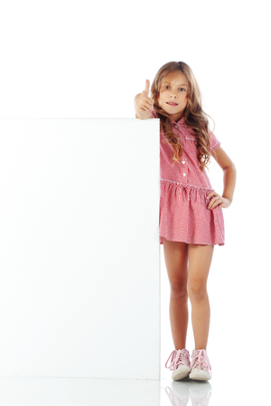 school uniform girl: Portrait of a school girl with blank board for custom text