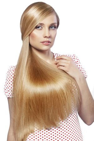 long straight hair: Portrait of young beautiful woman with long glossy blond hair