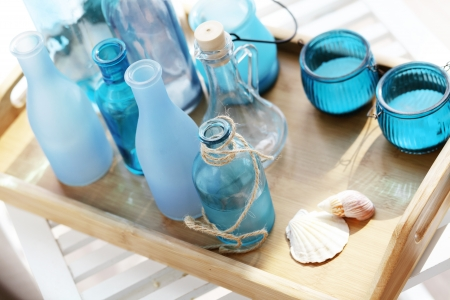 Collection of vintage bottles on a wooden tray photo