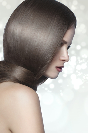 hairdo: Studio portrait of a model showing her healthy shining hair