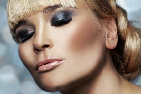 smokey: Studio shot of beautiful woman with smokey eyes makeup