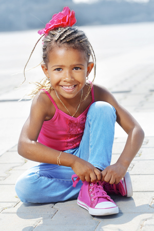 afro hairdo: Portrait of a 4 years fashion mulatto girl Stock Photo