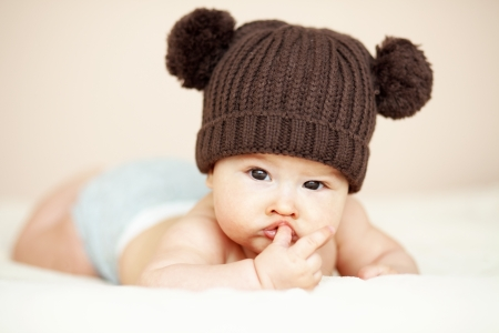 Portrait of a cute 3 monthes baby lying down on a blanket Stock Photo - 23302952