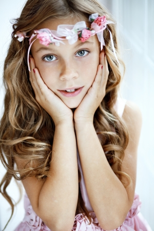 youngsters: Portrait of beautiful little girl wearing floral wreath