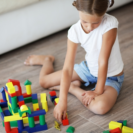 78: Child playing with blocks at home Stock Photo