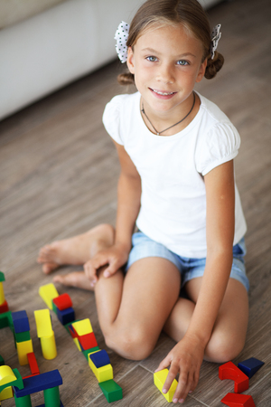 7 years old: Child playing with blocks at home Stock Photo