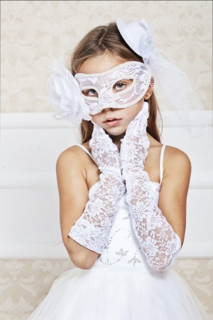 Portrait of a fashion girl wearing wedding dress and venetian mask Imagens