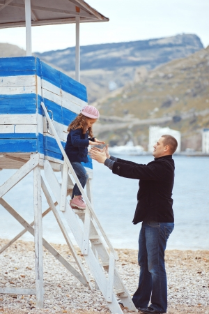 Portrait of father with his daughter on berth near sea in the city, still life photo photo