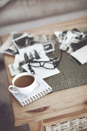 Still life details, cup of coffee and retro vintage black-and-white photos Stock Photo