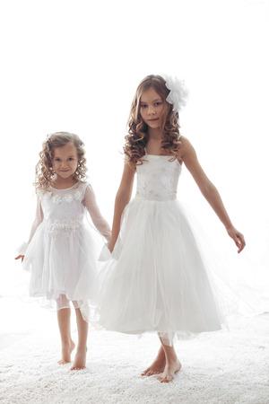 Beautiful little children wearing flower girl dresses