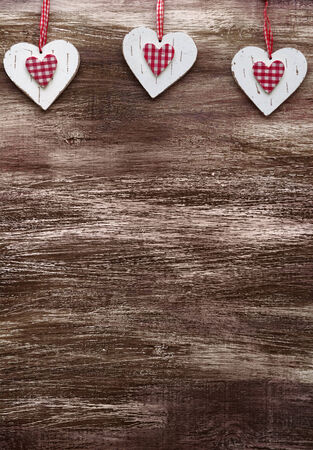 Shabby chic wooden shapes on vintage scratched background photo