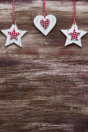 Shabby chic wooden shapes on rustic background photo