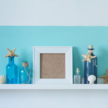 Idea of interior decoration with starfishes, glass bottles and wooden elements photo