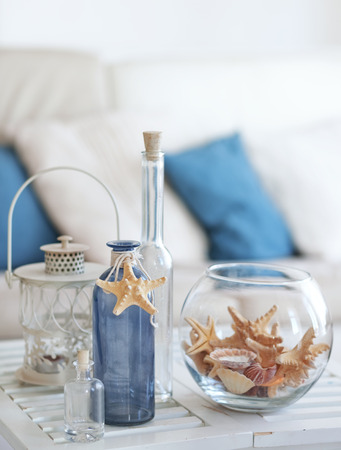 table decorations: Idea of interior decoration with starfishes and glass bottles