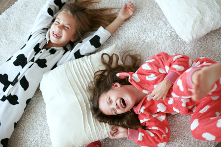 preteen girl: Children in soft warm pajamas playing at home