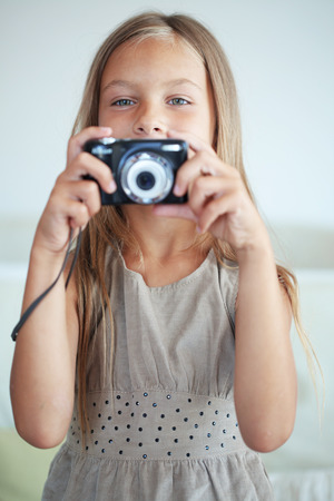 Little girl with compact camera