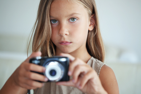 shootting: Little girl with compact camera