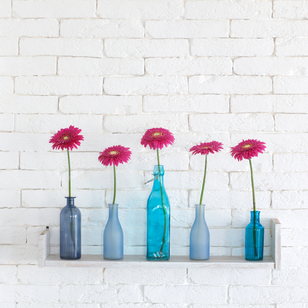 decorative shelf on white brick wall with flowers in vase on stock photo picture and royalty free image image