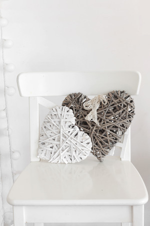 Rustic decor on a white shabby chic chair near the wall photo