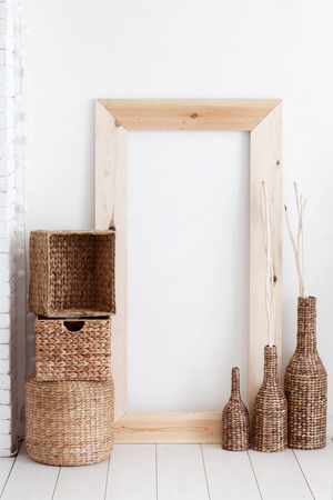 Vintage interior decor with wooden frame and wicker baskets photo