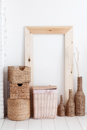 Vintage interior decor with wooden frame and wicker baskets Stock Photo