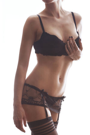 Slim woman in black lace lingerie isolated on white background photo