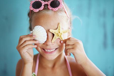 preteens beach: 7 years old child holding seashell