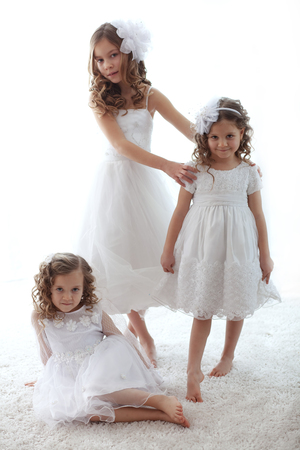Beautiful little children wearing flower girl dresses Stock Photo - 27580115