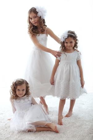 Beautiful little children wearing flower girl dresses Stock Photo - 27580115
