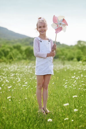 7 years old: 7 years old child having fun in flower field