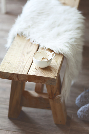 Still life details, cup of coffee on rustic bench, shallow focus Stock Photo