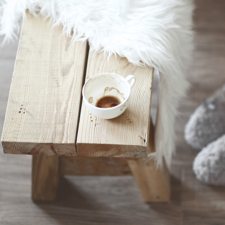 furniture detail: Still life details, cup of coffee on rustic bench, shallow focus Stock Photo