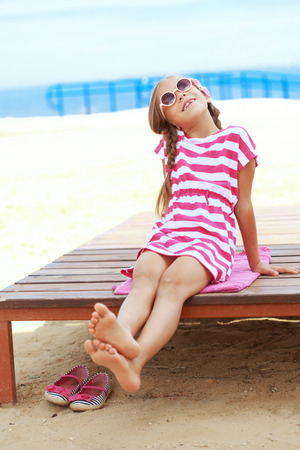 Child resting at the summer beach