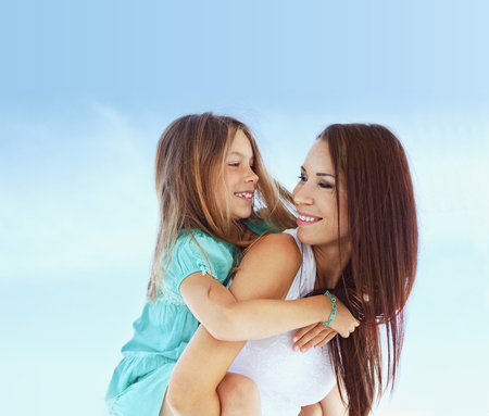 Mother with her 7 years old daughter having fun at beach in summer Stock Photo - 29005363