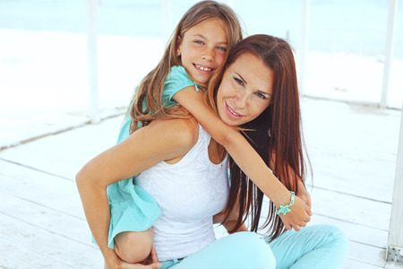Mother with her 7 years old daughter having fun at beach in summer Stock Photo - 29005419