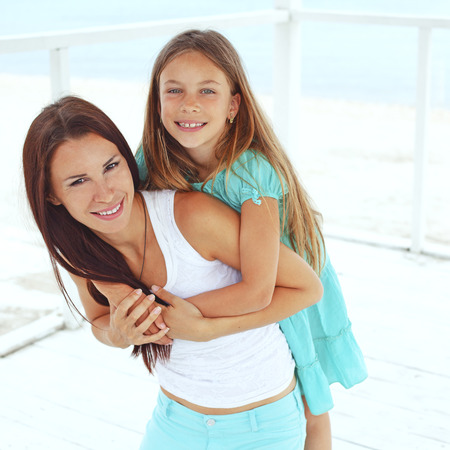 Mother with her 7 years old daughter having fun at beach in summer Stock Photo - 29005423