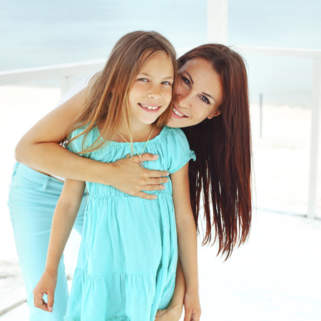 Mother with her 7 years old daughter having fun at beach in summer Stock Photo - 29005426
