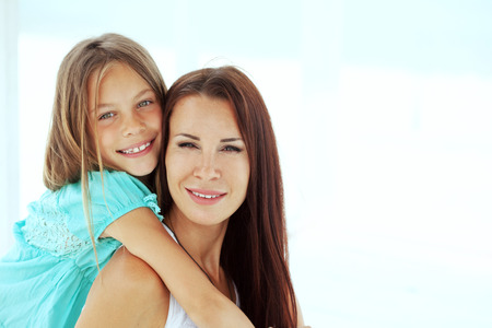 Mother with her 7 years old daughter having fun at beach in summer Stock Photo - 29005429