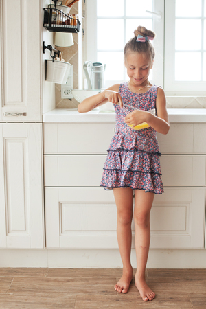 7 years old school girl cooking on the vintage kitchen, casual lifestyle photo series photo